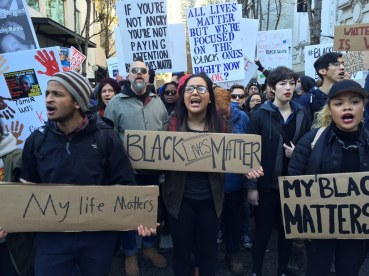 Chants at corner of 5th and Pike St during the Black Lives Matter protest, in Seattle, WA, Friday, Nov. 27, 2015. (Alan Berner / The Seattle Times)