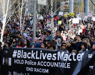 Protesters take part in a Black Lives Matter rally at the federal courthouse, Saturday, April 15, 2017, in downtown Seattle. Several thousand people attended a downtown rally and then marched to the courthouse to call attention to minority rights and police brutality. (AP Photo/Ted S. Warren)