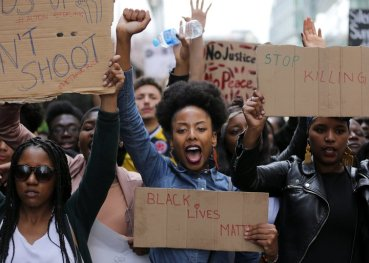 TOPSHOT - Demonstrators from the Black Lives Matter movement march through central London on July 10, 2016, during a demonstration against the killing of black men by police in the US. Police arrested scores of people in demonstrations overnight Saturday to Sunday in several US cities, as racial tensions simmer over the killing of black men by police. / AFP / DANIEL LEAL-OLIVAS (Photo credit should read DANIEL LEAL-OLIVAS/AFP/Getty Images)